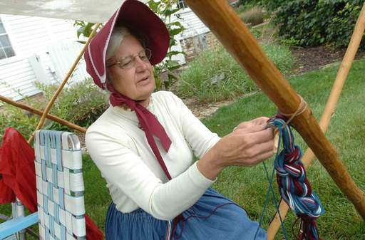 Susan Emore of Woodridge does some finger weaving at Depot Days in Lisle Saturday.