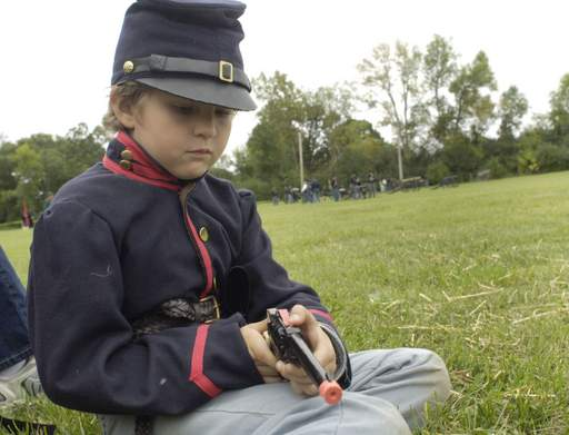 Spectator Eli Ornstein, 8, of Milwaukee loads his cap pistol while waiting for the battle re-enactment to start during Civil War Days at Lehmann Mansion Sunday in Lake Villa.