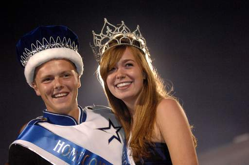 Seniors Derek Backer and Mallory Speck smile after being crowned homecoming king and queen during halftime of St. Charles North's game against Streamwood Friday in St. Charles.