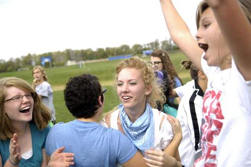 Freshmen Mikaela Dahlman, left, Cassidy Finnegan, Maddie King and Claire Speweik celebrate their class's win over the seniors during the annual class tug of war as part of homecoming activities at Westminster Christian School in Elgin Tuesday.