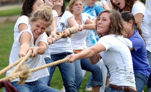 Seniors Maureen Sleeting, left, and Ellie Fick put their backs into it during the annual class tug of war as part of homecoming activities at Westminster Christian School in Elgin Tuesday.