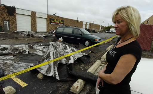 Anna Czapiuk, an employee at the Granite Counter Tops in the Wheeling looks over the storm damage last week at the store. She was worried about how long she would be out of work.