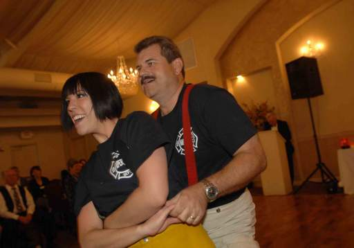 Mark Puknaitis and Kelly Lakomy do the hustle during the Dancing with Celebrities at Meson Sabika in Naperville Wednesday.