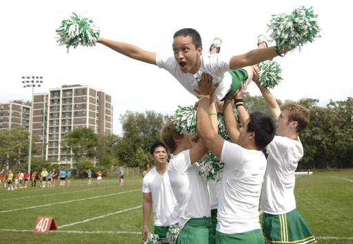 St. Edward cheerleaders hoist Fred De La Cruz into the air for seven mid-air push ups after a touchdown is scored in the freshman vs sophomores powder puff game on Thursday.