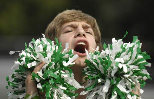 St. Edward junior Blase Horn stirs up the crowd in the stands for the powder puff games on Thursday, September 23.