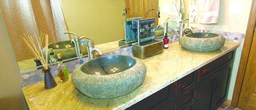Elite Transformations replaced the cabinet surface in the hall bath of Lisa Barker's Winfield home.