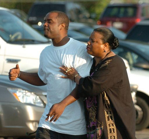 Angry members of Second Baptist Church in Wheaton leave a meeting Saturday in which the church ultimately decided to oust its longtime pastor, the Rev. Andre Allen.